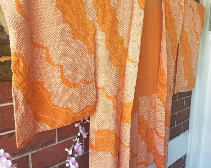 Vintage Japanese hand full shibori silk haori  kimono jacket in bright tangerine orange with green accents , hand stitched tangerine lining.