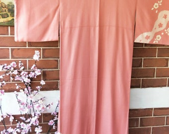 Vintage hand stitched salmon pink Japanese   houmongi silk kimono with woven pattern, shibori flowers and embroidered accents.