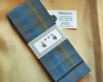 Men's kaku obi with textured woven pattern grey with soft muted blue and yellow, stripe reverse for kimono