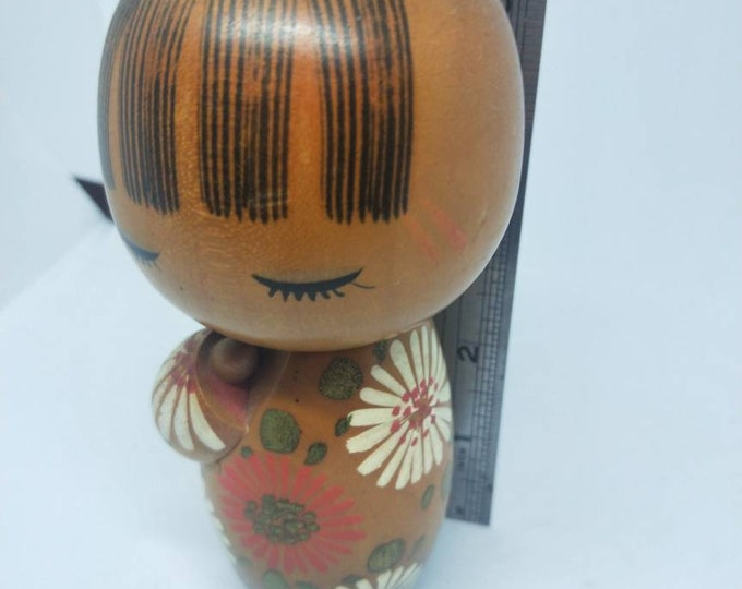 Vintage Wood Japanese girl  kokeshi doll, with chrysanthemum kimono and red bow. Not Mint. Absolutely Adorable. 15cm tall approximately.