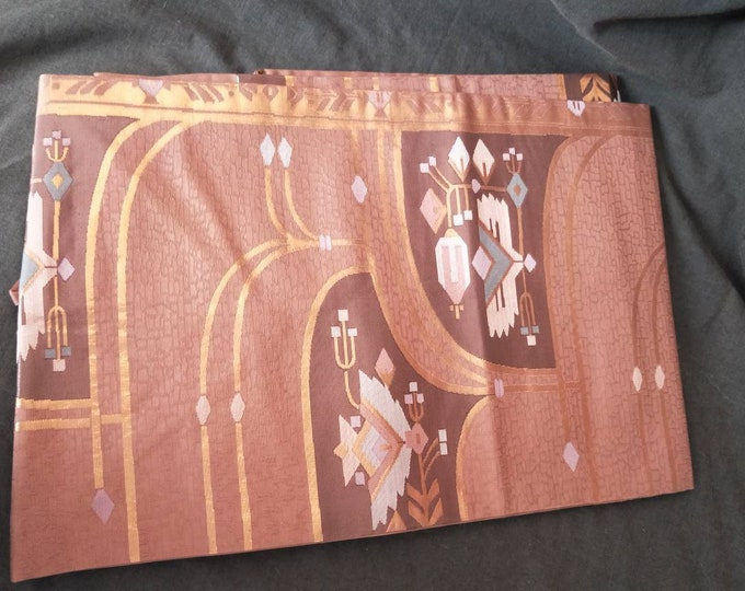 Beautiful vintage Japanese silk Nagoya obi, with abstract pattern dusky dark pink ground.
