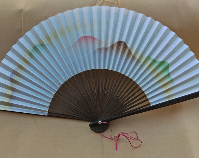 Vintage Japanese paper and wood fan, scenery with hint of gold.