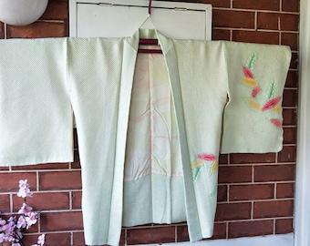 Vintage Japanese hand stitched shibori silk haori  kimono jacket in soft pistachio green, pink, topaz, lime accents ocean waves on lining.