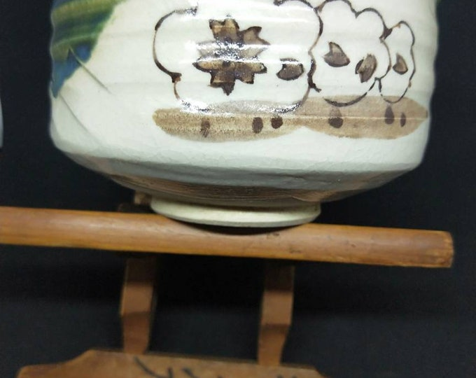 Vintage Japanese hand-made oribe-ware glazed tea bowl, chawan White stoneware body. Green gaze with pattern of Sakura. Signed.