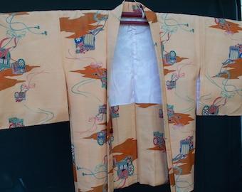 Vintage Japanese medium weight orange autumn shades haori kimono jacket with carriage and kumihimo pattern . Excellent condition. Unused