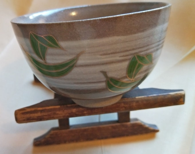 Vintage Japanese hand-made tea bowl. Cream and clear glaze with brush marks and on-glaze painting. Brown stoneware body.