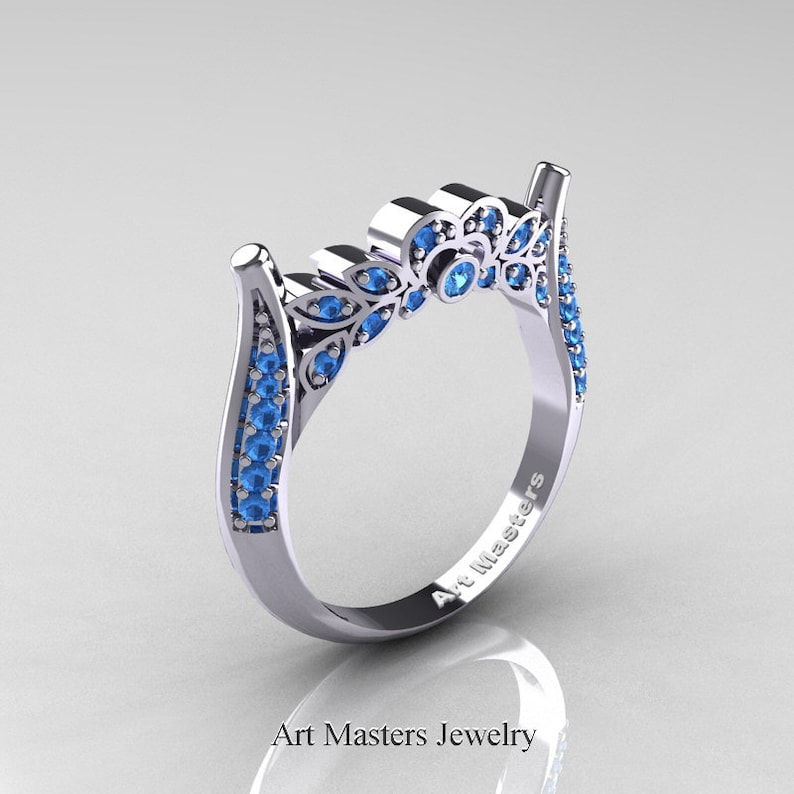 b221d5e29340 Clásico 14K oro blanco topacio azul descarga juego anillo de