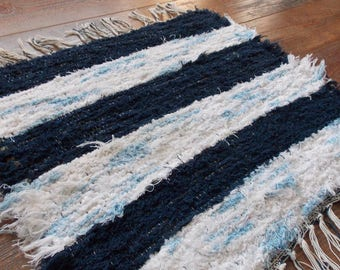 Small light blue and navy striped rug
