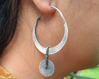 Simple earthy hoops with fun dangly discs. All sterling silver but NOT SHINY. great dancing movement, ebu Jewelry