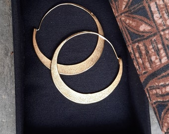 """Gold hoop earrings made for strong women. They are rustic, textured, gold plated jewelry.. 2 1/8"""" diameter."""