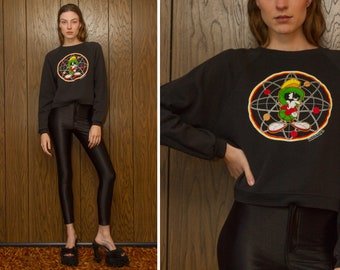 Vintage 90s Looney Tunes Warner Bros. 1996 Space Jams Marvin The Martian Nuclear Graphic Black Crewneck Raglan Long Sleeve Crop Sweatshirt S