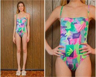 Vintage 90s Neon Pink Purple Green Blue Vapor Vaporwave Neon Topical Graphic Shapes Palm Tree Print Swimsuit One Piece Bodysuit Leotard S M