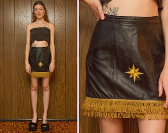 Vintage 90s Black Soft Leather Gold Shiny Bouillon Fringe Fringed Embroidered Northern 8 Point Star Metallic Holiday High Waist Mini Skirt S