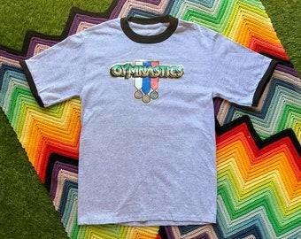 Vintage Unisex Gray Black Gymnastics Medals Ringer Crewneck Glitter Heat Transfer Funny Graphic Novelty Cotton Short Sleeve T-Shirt M L