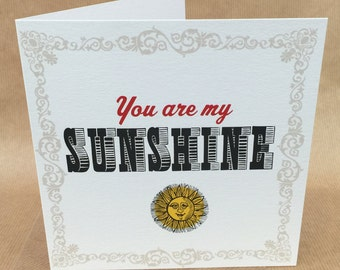 Sunny, light hearted retro typographic GREETINGS or BIRTHDAY card