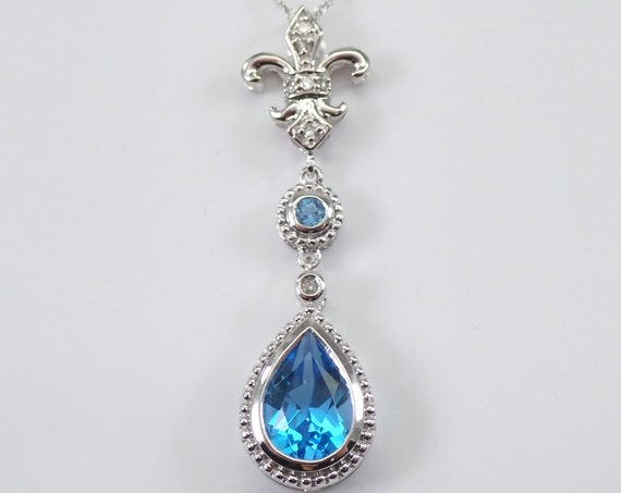 "Blue Topaz and Diamond Fleur De Lis Pendant 14K White Gold 18"" Chain Necklace December Birthstone Flower"