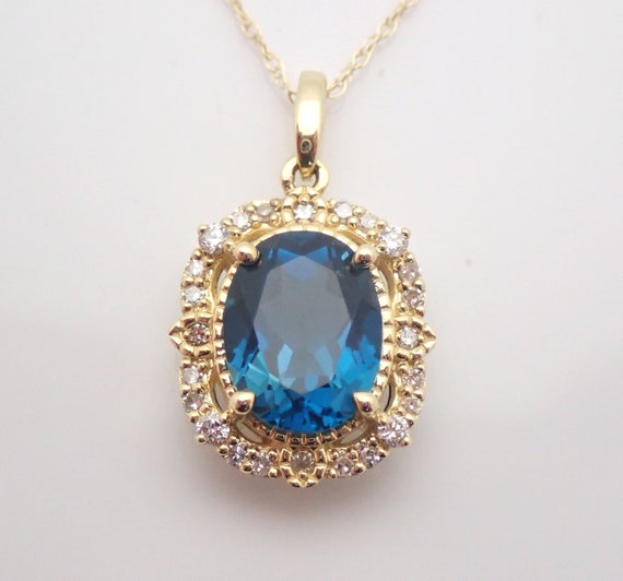 "Yellow Gold London Blue Topaz and Diamond Halo Pendant Necklace 18"" Chain"