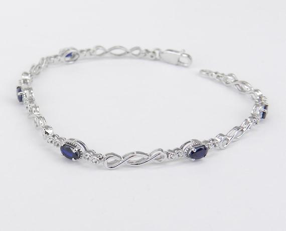 "White Gold Diamond and Sapphire INFINITY Style Tennis Bracelet 7.25"""