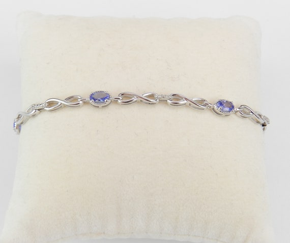 White Gold Diamond and Tanzanite INFINITY Style Tennis Bracelet 7.25""