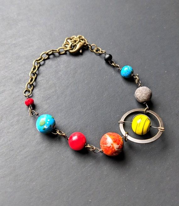 prezzo più basso 181c4 e219d Pianeti Bracciale - sistema solare Replica - nove pianeti - galassia -  modello sistema solare - Giove - Saturno - terra