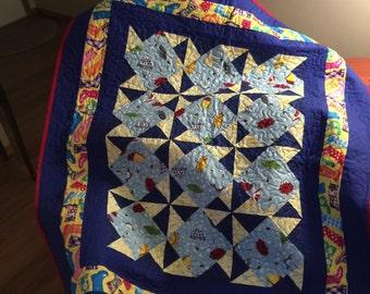 Bright rainy day pinwheel quilt