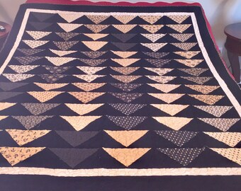 Black and Tan flying geese quilt. 59 by 68