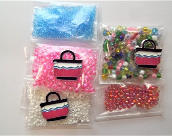 38g total bead weight seed beads 4mm and under. S48 Plus three purse charms