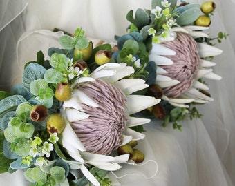 Bride, bridesmaid, flowergirl bouquet.  White King protea, wax flower, gumnuts and Australian native foliage.  Small rustic wedding bouquet
