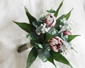 Bride, bridesmaid, flowergirl bouquet. Dark pink protea, grey gumnuts and Australian native foliage. Small rustic wedding bouquet.