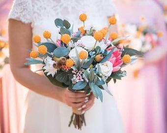 Rustic wedding bouquet.  Bride, bridesmaid bouquet of rustic, native flowers.  Protea, billy buttonhs, gumnuts.  Australian native flowers.