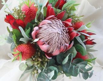 King protea bouquet. Wedding bouquet of rustic, native flowers.  Protea, bottlebrush, eucalyptus.  Australian wedding flowers. Silk flowers