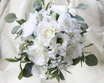 White faux flower wedding bouquet. Garden roses, lisianthus, gardenia, sweet peas, eucalyptus and olive foliage. Silk bouquet.