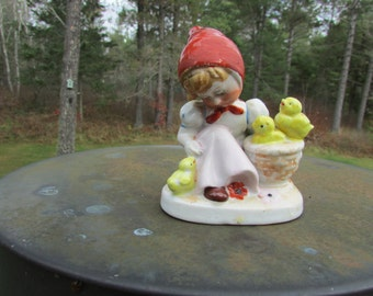 Woman with Red Bonnet and Chics in Basket Figurine Occupied in Japan