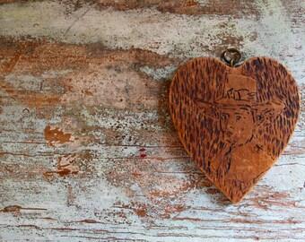 Antique wooden carved medallion