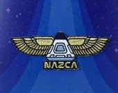 Winged Capsule - NAZCA An...