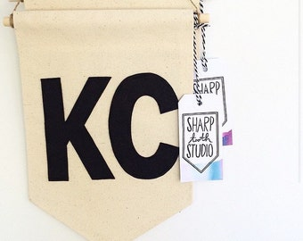 KC Banner - City or State Abbreviation Canvas Banner - 8 x 11.5 inch - Wall hanging
