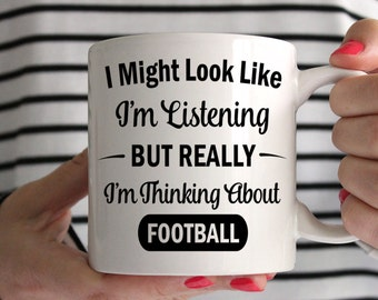 I Might Look Like I'm Listening But Really I'm Thinking About Football Mug