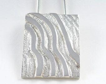 Desert Tracks sterling silver pendant