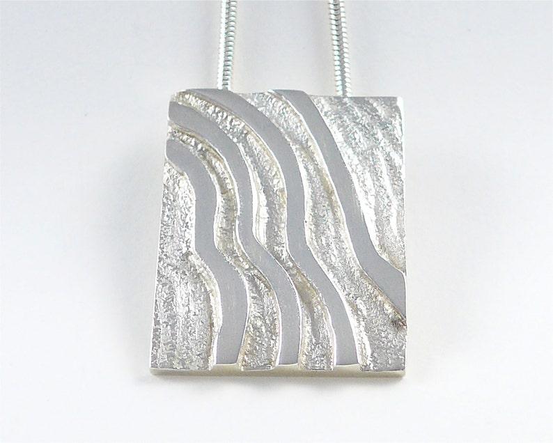 Desert Tracks sterling silver pendant image 0