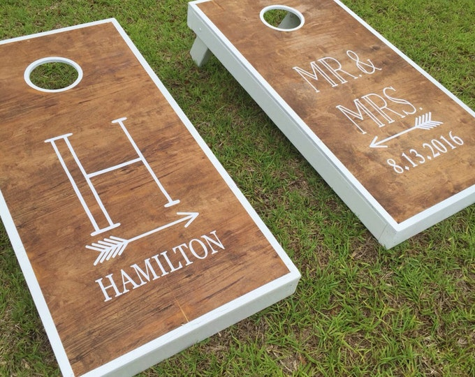 Featured listing image: Mr and Mrs Wedding Decals | Monogram with Arrow |  Wedding Date | Vinyl Decal Set for Cornhole Game Boards | Wedding Decor Rustic