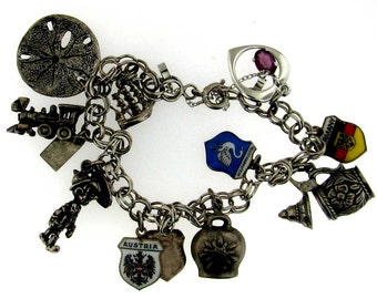 Silver charm bracelet Consisting of 11 Charms - Mostly Travel Related