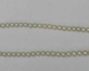 GRADUATED PEARL STRAND with White Gold Clasp
