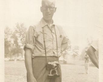 "Vintage Photo ""Serious Photographer"" SLR Camera Nerdy Guy Eyeglasses Arm Out Of Frame Found Vernacular Photo"