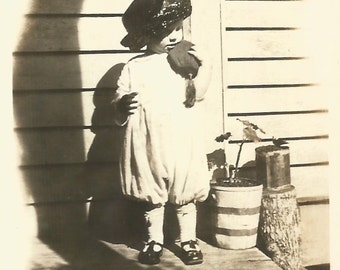 """Vintage Snapshot """"Playing Dress Up"""" Cute Little Girl Mother's Hat Purse Shadow Geraniums Found Vernacular Photo"""