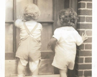 Losing His Diaper Toddlers At The Door Vintage Photo Little Boy & Girl Curly Hair Small Children Back To Camera Sepia Snapshot