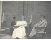 Corset Tiny Waist Woman Sitting With Cape Wearing Friend Woman Wearing Funny Hat Vintage Photo Victorian Era Fashion