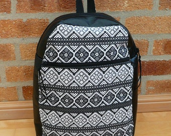 Backpack, black and white vinyl rucksack with top zipper closure