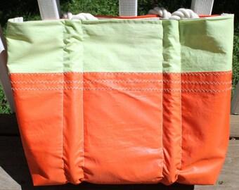 Recycled orange sail bag