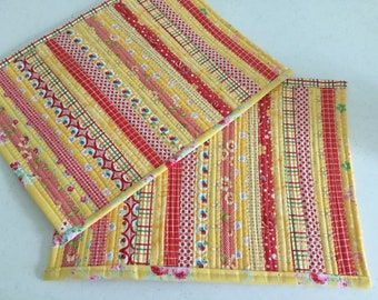 Pair of bright and colorful placemats