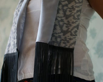 Grey and cream ikat woven scarf with a silk satin lining and charcoal grey fringing